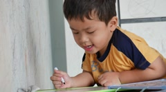 Little boy writing on white board in the room Stock Footage