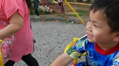 4K ; Little boy playing carouse at the playground. Stock Footage