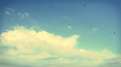 Timelapse of clouds moving from left to right. Vintage and grunge movie. Stock Footage