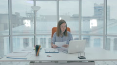 Frustrated young woman trying to work hard. But no good Stock Footage