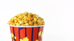 Cheese popcorn rotates on a white background. Medium shot Stock Footage