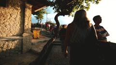 Tourists at the temple of Uluwatu. Pacific Ocean and temple View Stock Footage
