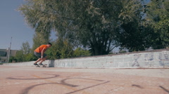 Young man jumping high on a skateboard in skate park. Slow motion, 100 fps Stock Footage