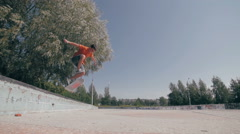 Skateboarder doing tricks in a city. Slow motion, 100 fps Stock Footage