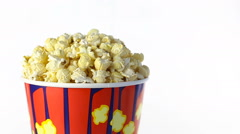 Salty popcorn rotates on a white background. Medium shot Stock Footage