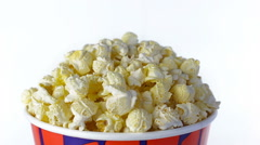 Salty popcorn rotates on a white background. Close up shot Stock Footage