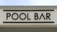 Close up of pool bar writing Stock Footage