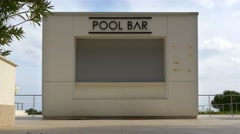 Closed small pool bar stand before holiday season Stock Footage