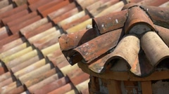 Close-up on red roof tiles and chimney of Duino castle Stock Footage