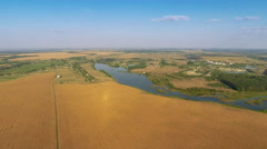 Flying Over Fields and River Stock Footage