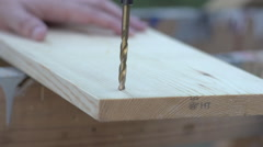 Slow Morion Large drill bit drilling into wooden board Stock Footage