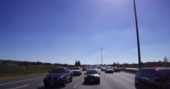 4K POV reverse angle heavy car and truck traffic on highway 401 Toronto Stock Footage