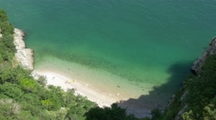 Aerial view to beautiful beach cove Stock Footage