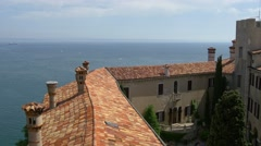 Duino castle over the rooftops looking into courtyard Stock Footage