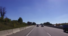4K reverse angle POV of traffic driving north on highway 400 away from Toronto Stock Footage