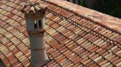 Chimney and red tiles on Duino castle rooftop Stock Footage
