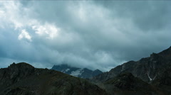 Mountain top with dramatic clouds Stock Footage