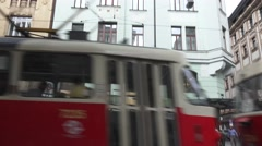 Tilt up to building while trolly passes Stock Footage