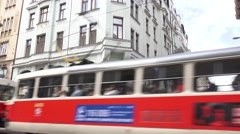 Trolly moving pass old hotel Stock Footage