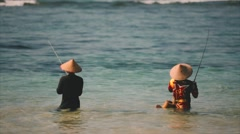 Traditional Balinese fishermen on the foreshore of Nusa Dua Beach Stock Footage