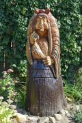The wooden statue of Baba Yaga in a mortar. Fairy-tale characters Baba Yaga,  Kuvituskuvat