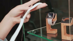 Young woman trying new smart watch. Smart watch. Young woman chooses to buy Stock Footage