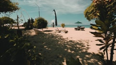 Nusa Dua beach. Tourists and children walking on the beach Stock Footage