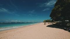 Nusa Dua beach. Tourists relaxing on the beach. Bali Indonesia Stock Footage