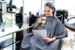 Client resting after hair coloring Stock Photos