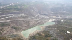 Aerial view on bucket wheel excavator and big dump truck in coal mine Stock Footage