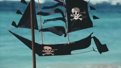 Black pirate ship shape kite for sale on Nusa Dua beach. Closeup.Bali Indonesia Stock Footage
