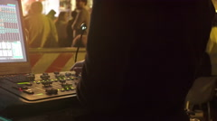 Lighting technician uses buttons during a disco party Stock Footage