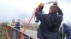 Trainer raises equipment on a rope Stock Footage