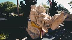 Stone statue of an elephant guard. Closeup. Bali Indonesia. Stock Footage