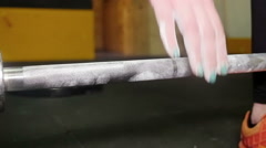 Athlete woman's talc hand grabs the barbell  Stock Footage