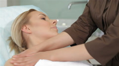Masseur massages girl's shoulders Stock Footage