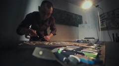 Calligrapher. Calligrapher man with glasses. Workshop calligrapher Stock Footage