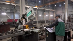 Automatic Band Saw Machine is sawing a metal I-beam. Stock Footage