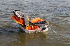 Rescue demonstration life raft opening in the water Stock Photos