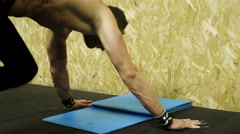 Crossfit athlete does the hand stand and starts push-ups Stock Footage