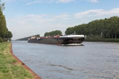 Barge navigating at Dutch canal near Amsterdam Stock Photos