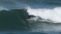 Charly Martin, surging, Guincho's Beach - Cascais, Portugal Stock Footage