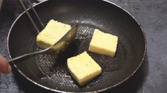 Frying Polenta Squares Cooking series Stock Footage