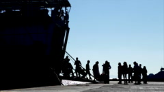 Silhouetted passengers board a ferry at Skala harbour, Patmos Stock Footage