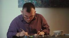 Calligrapher. Calligrapher man with glasses. Workshop calligrapher Stock Footage