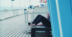 Young couple hanging out on Bournemouth Pier Stock Footage