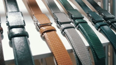 A new collection of leather belts for trousers in a shop  Stock Footage