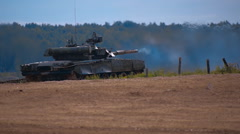 Tank T-90 is on the range and shoot at targets during military exercises Stock Footage