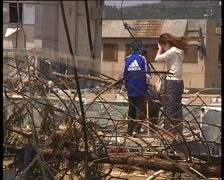 Family looking for home stuff on the site of their destroyed house. Stock Footage