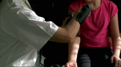 Doctor taking a patient's blood pressure  Stock Footage